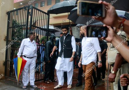 Bollywood actor Abhishek Bachchan, center, leaves after attending the funeral of the Bollywood actor Shashi Kapoor in Mumbai, India, . Kapoor, a leading Bollywood actor and producer from the 1970s and '80s, died Monday after a long illness. He was 79