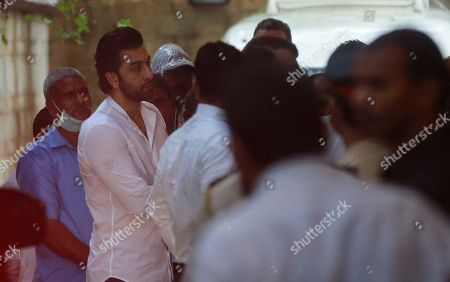 Bollywood actor Ranbir Kapoor, second from left, arrives to attend the funeral of the Bollywood actor Shashi Kapoor in Mumbai, India, . Kapoor, a leading Bollywood actor and producer from the 1970s and '80s, died Monday after a long illness. He was 79
