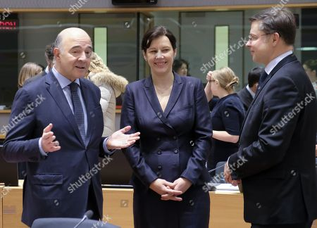 Pierre Moscovici (L), the European Commissioner for Economic and Financial Affairs, Taxation and Customs, speaks with  Latvian Finance Minister Dana Reizniece-Ozola (C) and European Commissioners Valdis Dombrovskis (R) during an European Finance Ministers Council meeting in Brussels, Belgium, 05 December 2017.
