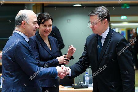 Stock Picture of Pierre Moscovici, Valdis Dombrovskis, Dana Reizniece Ozola