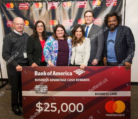 Local entrepreneur Gretta Monahan presents the $25,000 check to winner of the Mastercard Grow Your Biz Contest in partnership with Bank of America, Rachel Estapa, at the final event at District Hall, in Boston