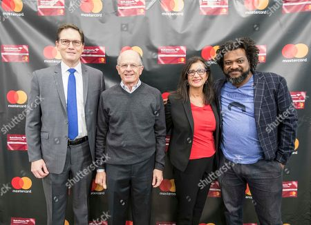 "Kevin Kelly of Bank of America, from left, Barry Charton of SCORE Boston, Ginger Siegel of Mastercard and Bonin Bough of CNBC's ""Cleveland Hustles"" arrive at the Mastercard Grow Your Biz Contest final event in partnership with Bank of America at District Hall, in Boston"