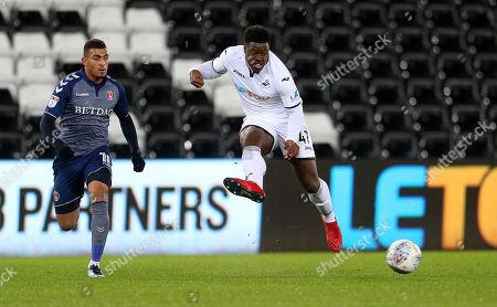 Tyler Reid of Swansea City crosses the ball.
