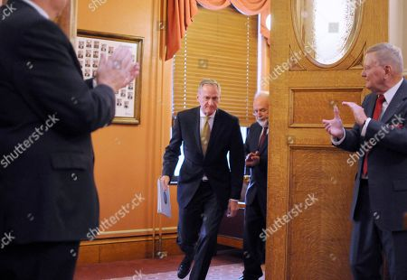 Stock Picture of South Dakota Gov. Dennis Daugaard walks into the House chamber at the state Capitol in Pierre, S.D., to deliver his annual budget address to the state Legislature