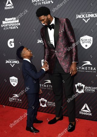 """Maxwell Young, Joel Embiid. S.I. Kids SportsKid of the year honoree Maxwell """"Bunchie"""" Young, left, meets rising star award recipient Joel Embiid, at the Sports Illustrated 2017 Sportsperson of the Year Awards at the Barclays Center, in New York"""