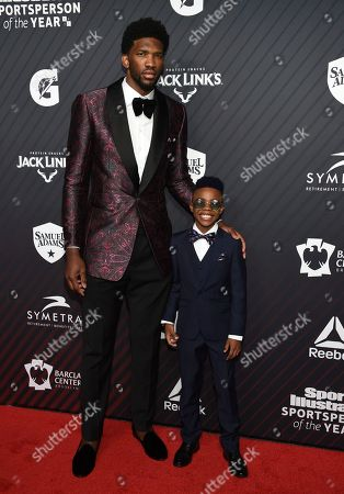 """Joel Embiid, Maxwell Young. S.I. Kids SportsKid of the year honoree Maxwell """"Bunchie"""" Young, right, meets rising star award recipient Joel Embiid, at the Sports Illustrated 2017 Sportsperson of the Year Awards at the Barclays Center, in New York"""