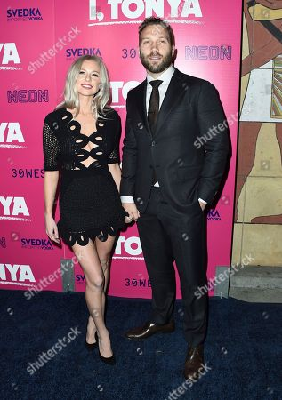 """Mecki Dent, Jai Courtney. Mecki Dent, left, and Jai Courtney arrive at the Los Angeles premiere of """"I, Tonya"""" at the Egyptian Theatre on"""