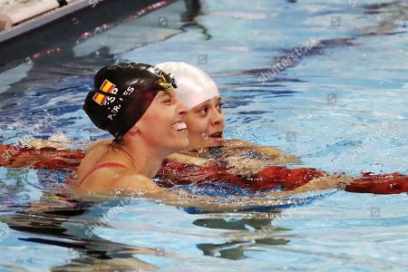 Teresa Perales (L) of Spain and Joana Silva (R) of Brazil watch their marks at the end of the final 50 meters free category S5 women event, during the Paralympic World Swimming Championships in Mexico City, Mexico, 05 December 2017.