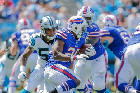 Buffalo Bills' LeSean McCoy (25) runs by Carolina Panthers' Shaq Green-Thompson (54) who runs by the block of John Miller (76) during the first half of an NFL football game in Charlotte, N.C., . The Panthers won 9-3