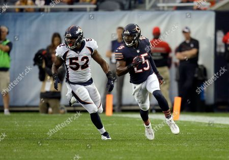 Denver Broncos inside linebacker Corey Nelson (52) defends Chicago Bears running back Ka'Deem Carey (25) during the first half of an NFL preseason football game, in Chicago