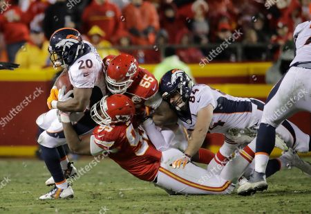 Denver Broncos running back Justin Forsett (20) is tackled by Kansas City Chiefs defensive lineman Chris Jones (95) and linebacker Dee Ford (55), with Denver Broncos tight end Henry Krieger-Coble (84) joining in, during the first half of an NFL football game in Kansas City, Mo