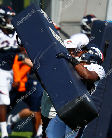 Denver Broncos inside linebacker Corey Nelson (52) during drills at an NFL football camp, in Englewood, Colo