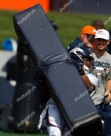 Corey nelson. Denver Broncos inside linebacker Corey Nelson (52) takes part in drills at an NFL football training camp, in Englewood, Colo
