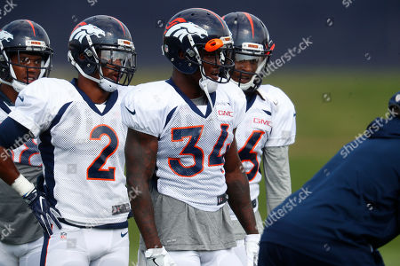 Denver Broncos defensive back Will Parks (34) and Denver Broncos defensive back Dante Barnett (2) during an NFL football training camp, in Englewood, Colo