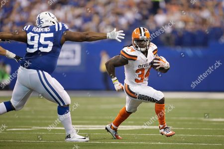 Cleveland Browns running back Isaiah Crowell (34) runs around Indianapolis Colts defensive end Johnathan Hankins (95) during the first half of an NFL football game in Indianapolis