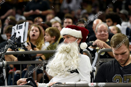 Former New Orleans Saints player Steve Gleason, who suffers from amyotrophic lateral sclerosis (ALS) wears a Santa Claus beard, in the second half of an NFL football game between the Saints and the Tampa Bay Buccaneers in New Orleans