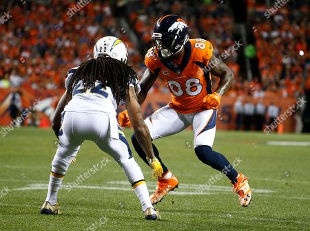 Denver Broncos wide receiver Demaryius Thomas (88) lines up against Los Angeles Chargers cornerback Jason Verrett (22) during the first half of an NFL football game, in Denver
