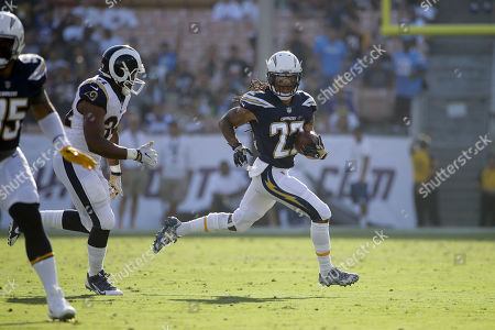 Los Angeles Chargers cornerback Jason Verrett runs after an interception during the first half of a preseason NFL football game against the Los Angeles Rams, in Los Angeles