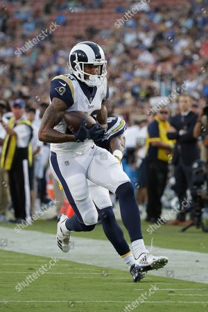 Los Angeles Rams wide receiver Josh Reynolds hauls in a pass on his way to scoring a touchdown as Los Angeles Chargers cornerback Randall Evans (41) defends during the second half of a preseason NFL football game, in Los Angeles