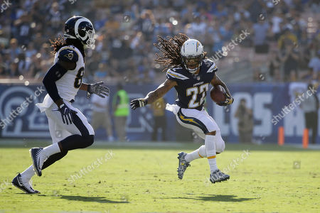 Los Angeles Chargers cornerback Jason Verrett, right, tries to get past Los Angeles Rams tight end Temarrick Hemingway after an interception during the first half of a preseason NFL football game, in Los Angeles