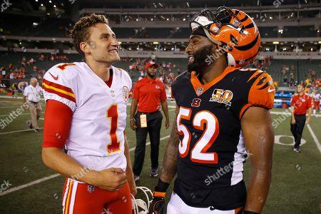 Kansas City Chiefs kicker Sam Ficken (1) meets with Cincinnati Bengals linebacker Brandon Bell (52) after an NFL preseason football game, in Cincinnati. The Chiefs won 30-12