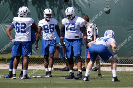 Indianapolis Colts tight end Erik Swoope (86) and offensive lineman Zack Banner (72) lineup for a drill during the NFL team's football practice in Indianapolis