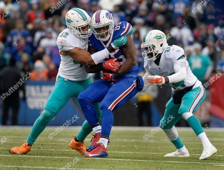 Charles Clay, Spencer Paysinger, Isa Abdul-Quddus. Buffalo Bills tight end Charles Clay (85) is tackled by Miami Dolphins linebacker Spencer Paysinger (42) and safety Isa Abdul-Quddus (24) during the second half of an NFL football game, in Orchard Park, N.Y