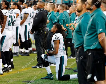 Philadelphia Eagles cornerback Ron Brooks kneels during the National Anthem before an NFL preseason football game against the Miami Dolphins at Lincoln Financial Field in Philadelphia