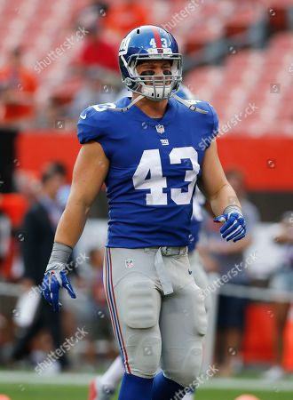 New York Giants' Shane Smith warms up before an NFL football game against the Cleveland Browns, in Cleveland