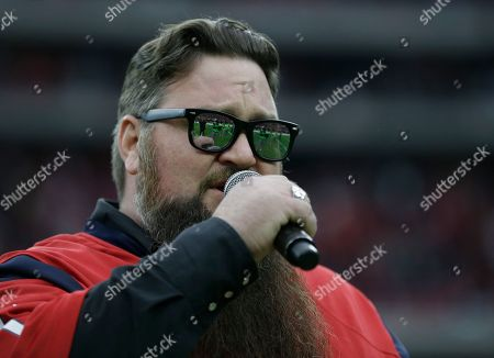 The Voice winner Sundance Head performs the national anthem an NFL football game, in Houston