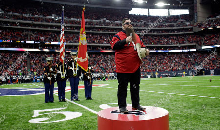 Sundance Head sings the National Anthem before an NFL football game between the Jacksonville Jaguars and Houston Texans, in Houston