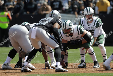 New York Jets quarterback Josh McCown (15) stands behind center Wesley Johnson (76) against the Oakland Raiders during an NFL football game in Oakland, Calif