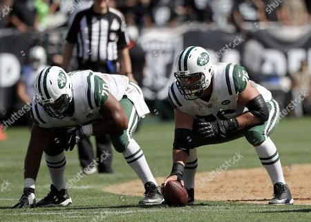 New York Jets offensive guard Dakota Dozier (70) and center Wesley Johnson (76) line up against the Oakland Raiders during an NFL football game in Oakland, Calif