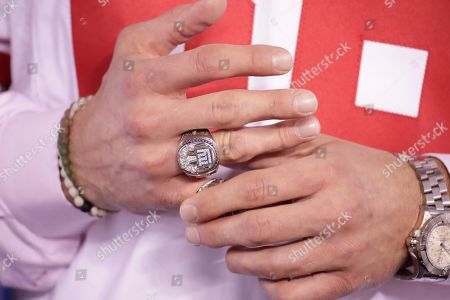 Former New York Giants player David Diehl adjusts his Super Bowl ring during a halftime ceremony of an NFL football game between the New York Giants and the Detroit Lions, in East Rutherford, N.J