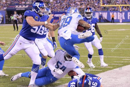 Detroit Lions cornerback Jamal Agnew (39) is forced out of bounds by New York Giants' Zak DeOssie (51) during the first half of an NFL football game, in East Rutherford, N.J
