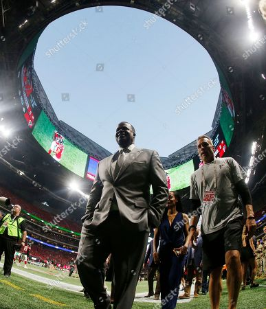 Atlanta Mayor Kasim Reed walks on the turf before the first of an NFL football game between the Atlanta Falcons and the Green Bay Packers, in Atlanta