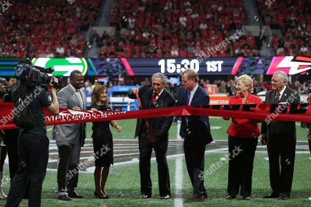 Atlanta Mayor Kasim Reed, Angela Macuga, Atlanta Falcons owner Arthur Blank, NFL commissioner Roger Goodell, Sandra Dunagan, Georgia Gov. Nathan Deal, from left, walk to the center of the field for a ribbon cutting before the first of an NFL football game between the Atlanta Falcons and the Green Bay Packers, in Atlanta