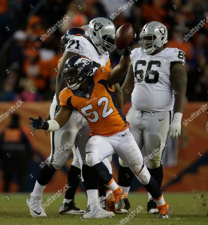 Denver Broncos inside linebacker Corey Nelson (52) reacts to a play against the Oakland Raiders in the second half of an NFL football game, in Denver