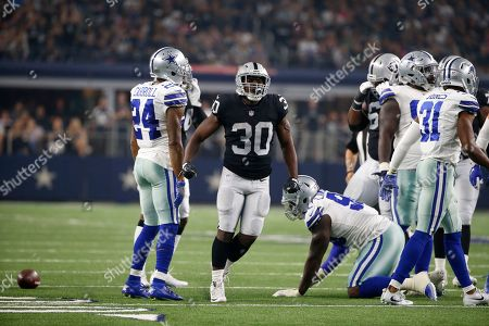 Oakland Raiders' Jalen Richard (30) celebrates in front o Dallas Cowboys' Nolan Carroll II (24) after running the ball in the first half of a preseason NFL football game, in Arlington, Texas