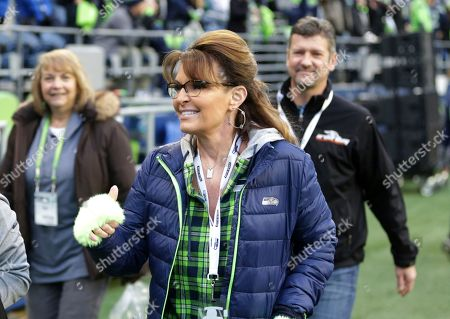 Sarah Palin, political commentator and former Governor of Alaska, walks on the sideline before an NFL football game between the Seattle Seahawks and the Los Angeles Rams, in Seattle