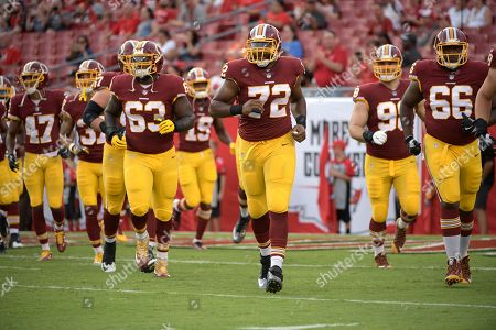 Washington Redskins defensive end Brandon Banks (63), offensive tackle Kevin Bowen (72) and offensive tackle Kendall Pace (66) jog to the sideline before the start of an NFL preseason football game against the Tampa Bay Buccaneers, in Tampa, Fla
