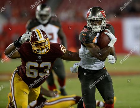 Tampa Bay Buccaneers wide receiver Derel Walker (87) breaks away from Washington Redskins defensive end Brandon Banks (63) during the fourth quarter of an NFL preseason football game, in Tampa, Fla