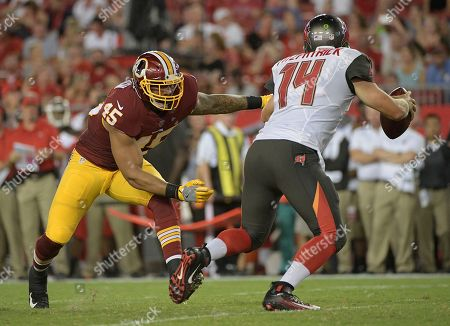 Washington Redskins linebacker Pete Robertson (45) misses a tackle on Tampa Bay Buccaneers quarterback Ryan Fitzpatrick (14) during the second quarter of an NFL preseason football game, in Tampa, Fla