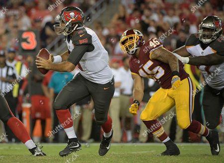 Tampa Bay Buccaneers quarterback Sefo Liufau (8) runs away from Washington Redskins linebacker Pete Robertson (45) during the second quarter of an NFL preseason football game, in Tampa, Fla