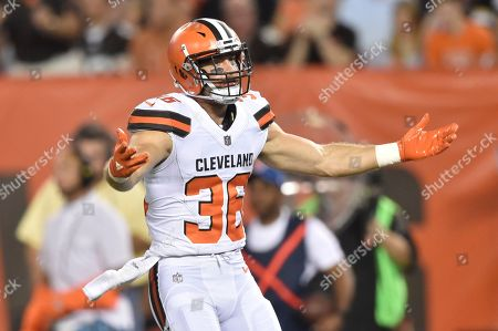 Cleveland Browns defensive back Justin Currie stands on the field during an NFL preseason football game against the New Orleans Saints, in Cleveland. The Browns won 20-14