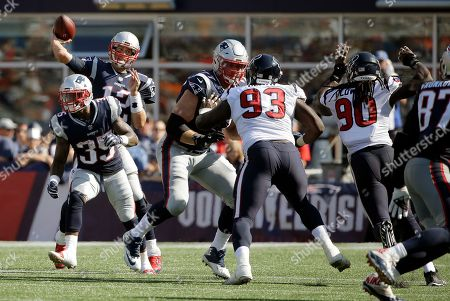 New England Patriots quarterback Tom Brady (12) passes under pressure from Houston Texans defensive end Joel Heath (93) and linebacker Jadeveon Clowney (90) during the second half of an NFL football game, in Foxborough, Mass