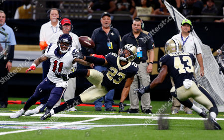 New Orleans Saints cornerback Marshon Lattimore (23) breaks up a pass intended for Houston Texans wide receiver Jaelen Strong (11) in the first half of a preseason NFL football game in New Orleans
