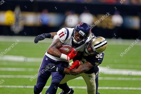 Houston Texans wide receiver Jaelen Strong (11) is tackled by New Orleans Saints strong safety Kenny Vaccaro (32) in the first half of a preseason NFL football game in New Orleans