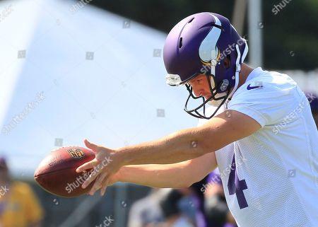 Minnesota Vikings punter Ryan Quigley (4) practice his drop during NFL football training camp, in Mankato, Minn