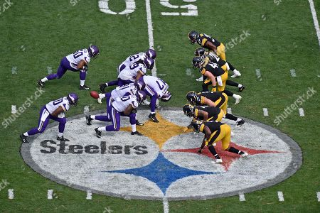 Minnesota Vikings long snapper Kevin McDermott (47) snaps the ball to punter Ryan Quigley during the second half of an NFL football game against the Pittsburgh Steelers in Pittsburgh, . The Steelers won 26-9